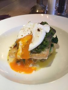 Pan fried cod with split runny egg