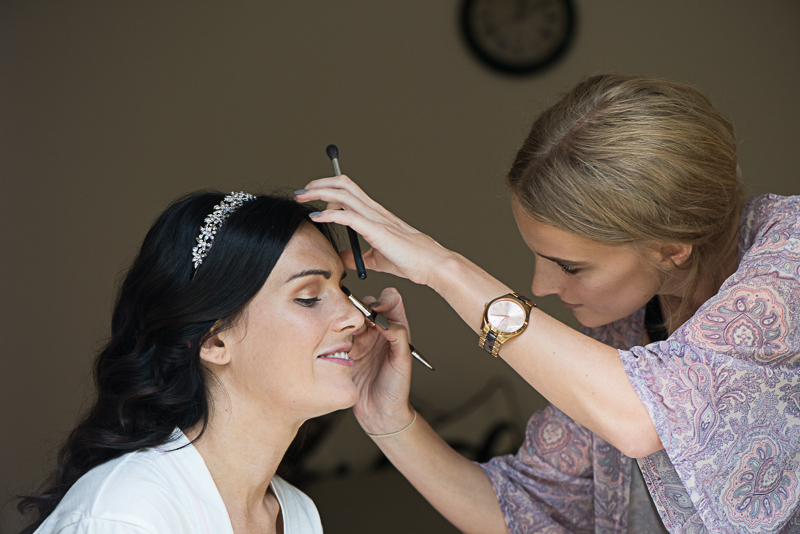 Bride with make up artist